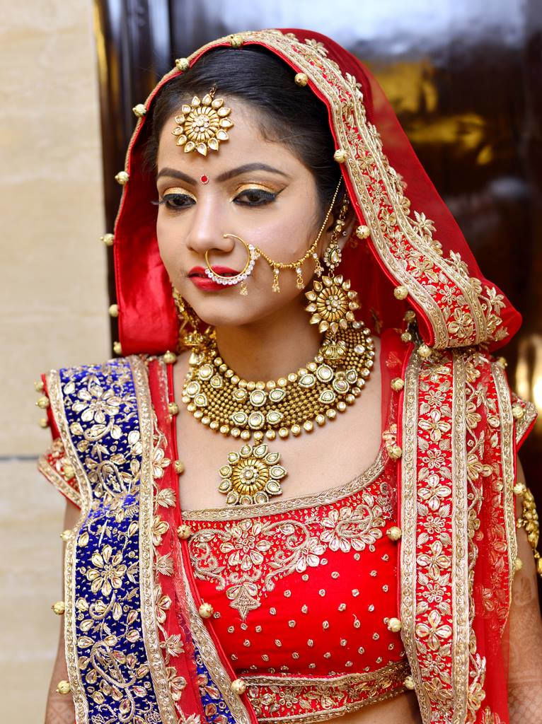 Glowing Bride Adorned With Gold And Kundan Jewellery by Arpit Gulati Bridal-makeup Bridal-jewellery-and-accessories | Weddings Photos & Ideas
