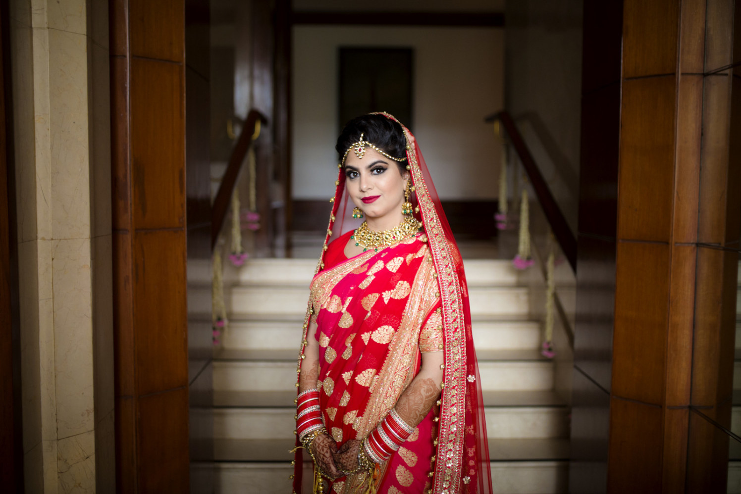 The Bride Looking Stunning In Crimson Red Lehenga With Golden Embroidery by Arpit Gulati Wedding-photography Bridal-jewellery-and-accessories | Weddings Photos & Ideas