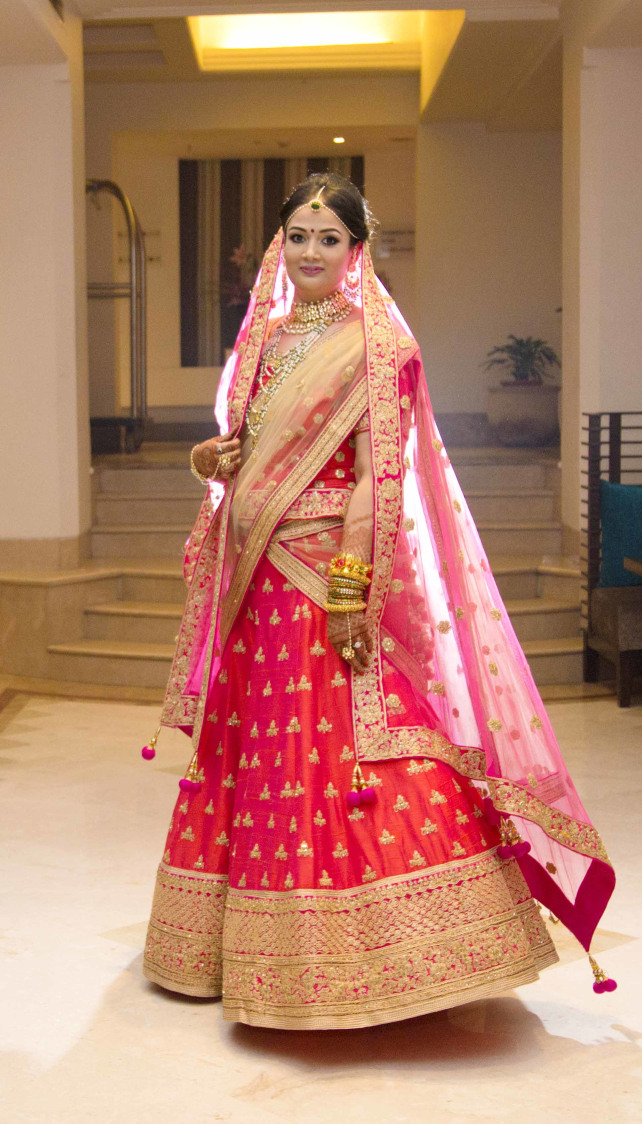 Rajasthani Bride Wearing Pink Lehenga With Golden Embroidery by Arpit Gulati Wedding-photography Wedding-dresses | Weddings Photos & Ideas
