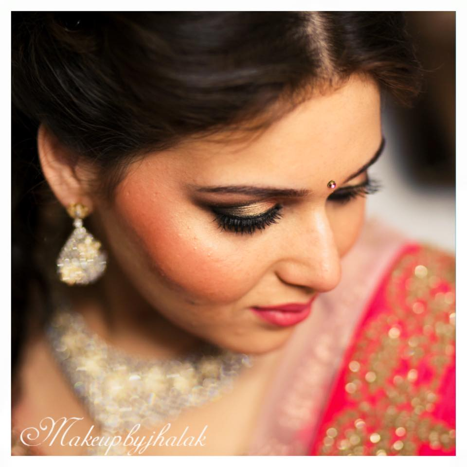 Golden eye shadow with smokey eyes! by Jhalak Parswani Bridal-makeup | Weddings Photos & Ideas