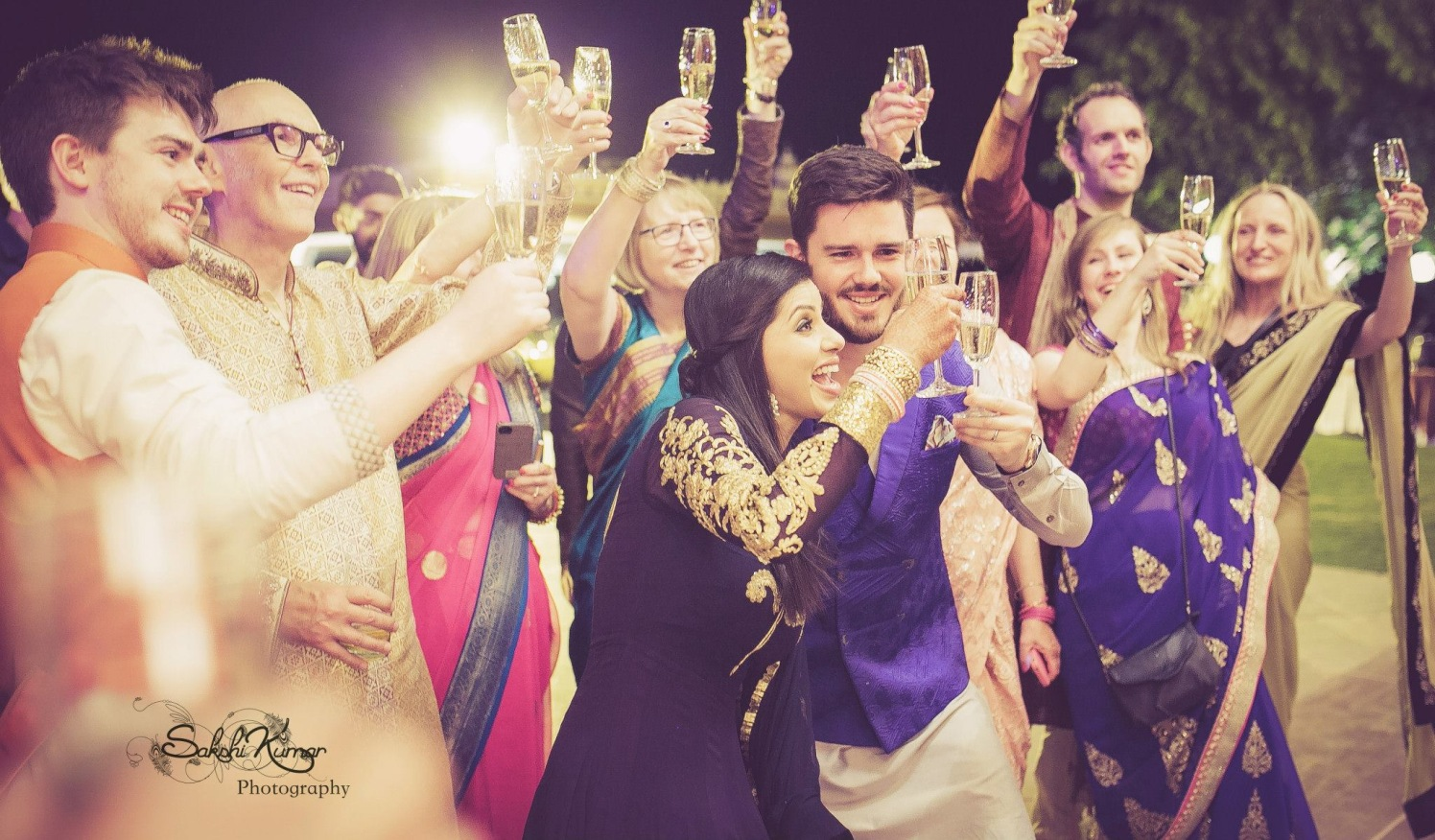 Family Cheers To The Charming Couple by Sakshi Kumar Wedding-photography | Weddings Photos & Ideas