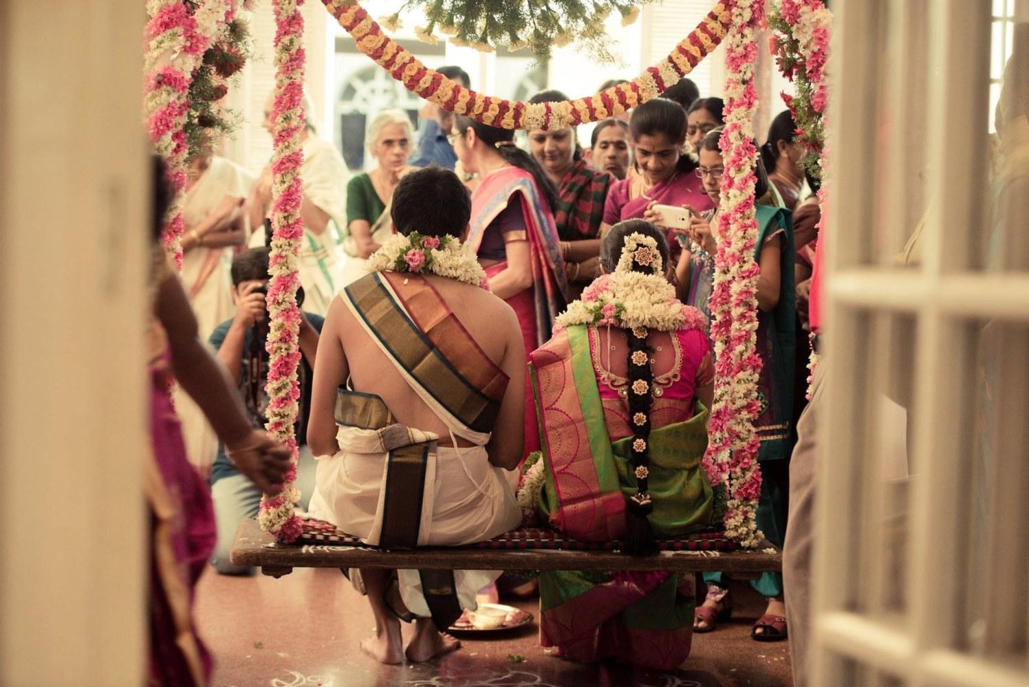 Flower adorned swing by Click n' Cherish Wedding-photography | Weddings Photos & Ideas