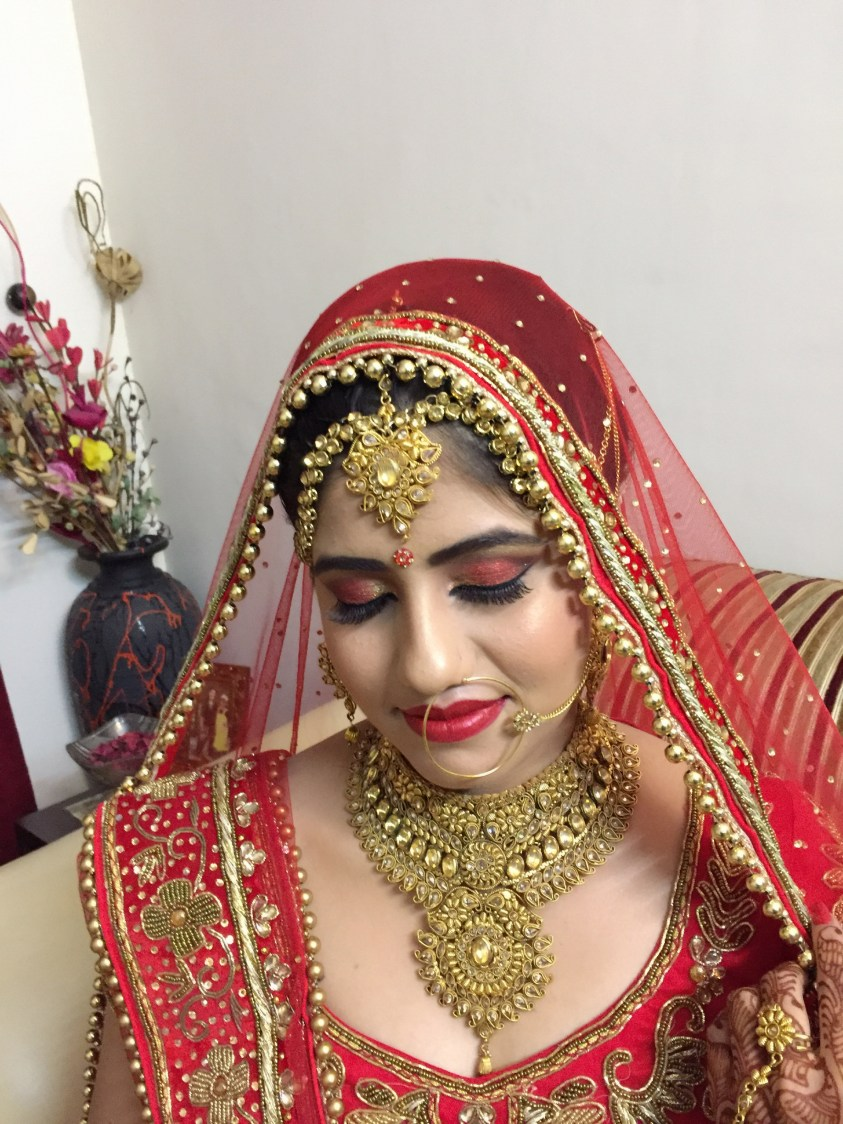 Shade of red with a glint of gold by Richa Malik Bridal-makeup | Weddings Photos & Ideas