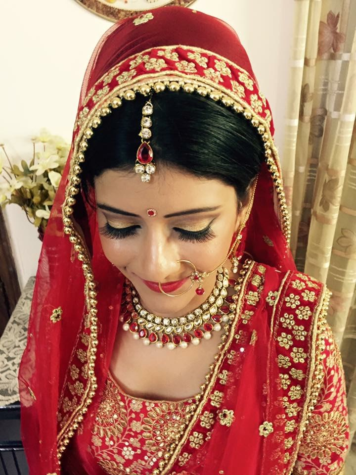 Natural look with classic red by Richa Malik Bridal-makeup | Weddings Photos & Ideas