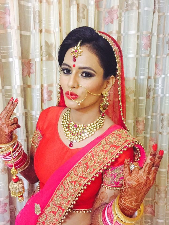 Red and pink for a feminine touch by Richa Malik Bridal-makeup | Weddings Photos & Ideas