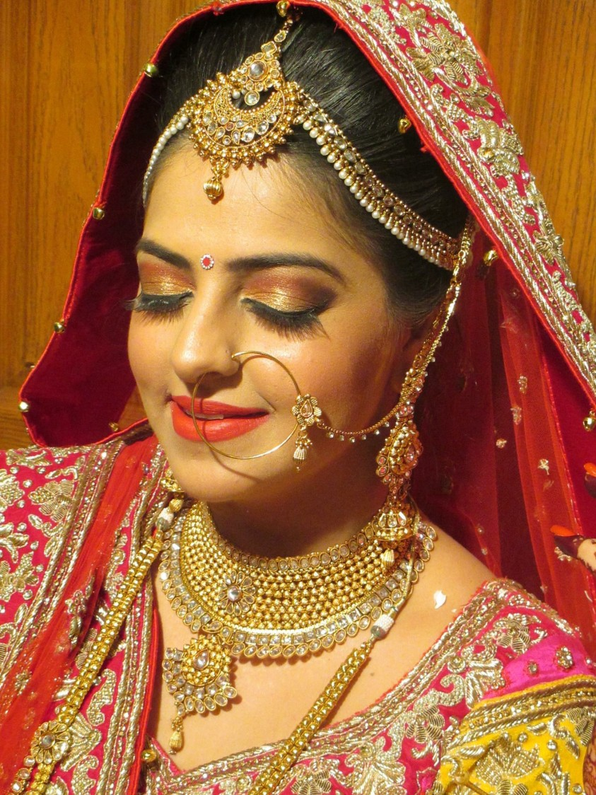 Golden shimmery eye shadow with a speck of red! by Richa Malik Bridal-makeup | Weddings Photos & Ideas