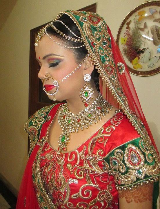 Bride all primped up by Richa Malik Bridal-makeup | Weddings Photos & Ideas