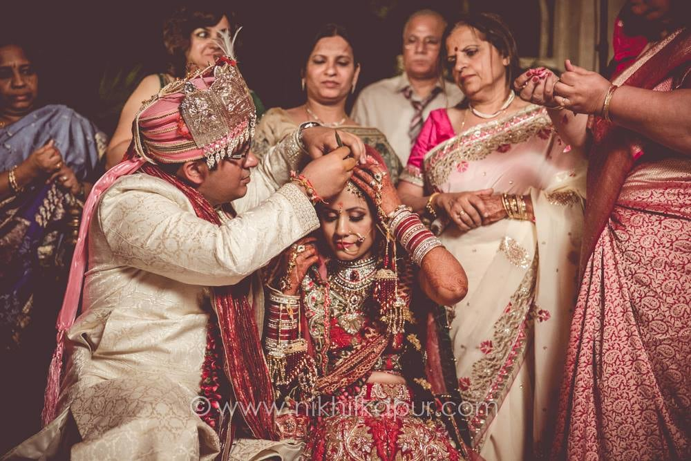Candid couple at the ceremony by Nikhil Kapur Photography Wedding-photography | Weddings Photos & Ideas
