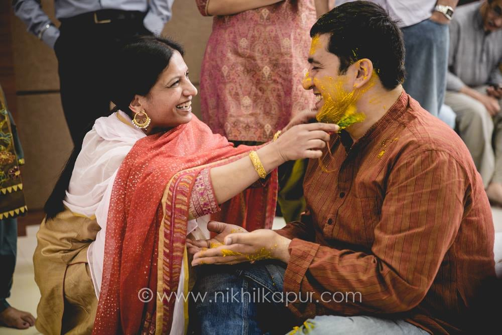 Haldi ceremony in full swing by Nikhil Kapur Photography Wedding-photography | Weddings Photos & Ideas