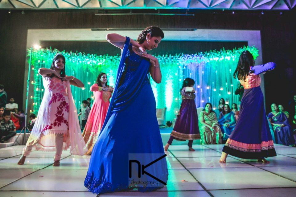 The dancers grace the stage by Nikhil Kapur Photography Wedding-photography | Weddings Photos & Ideas