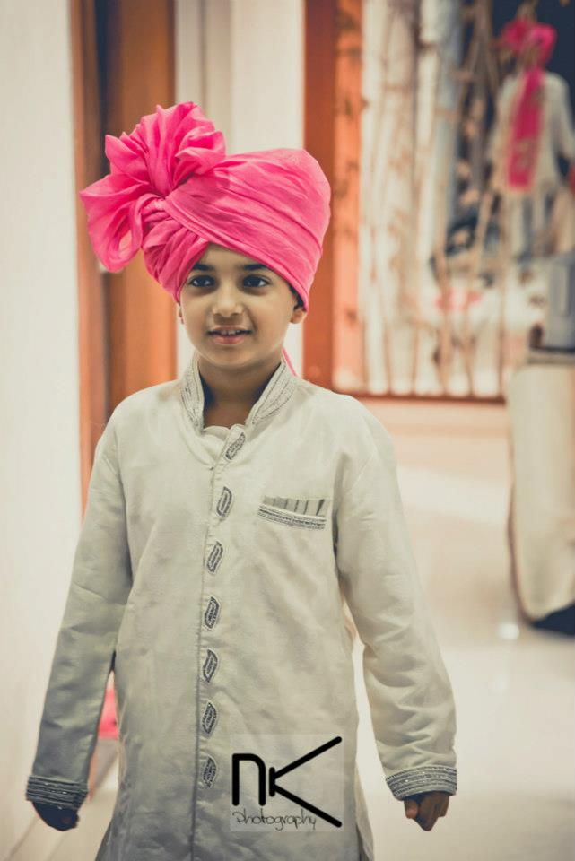 The cute kid graces the occasion by Nikhil Kapur Photography Wedding-photography | Weddings Photos & Ideas