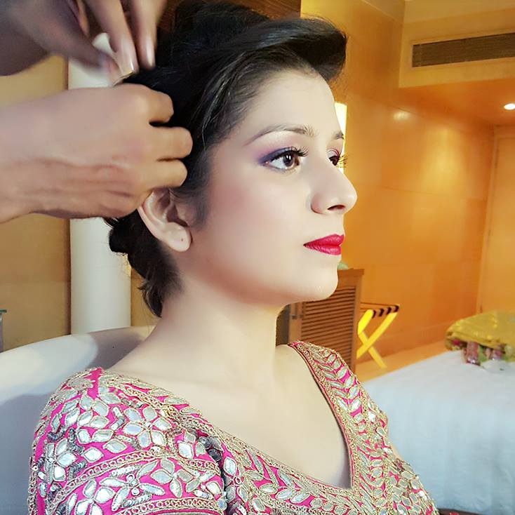 Bride getting ready by Nishi Singh Bridal-makeup | Weddings Photos & Ideas