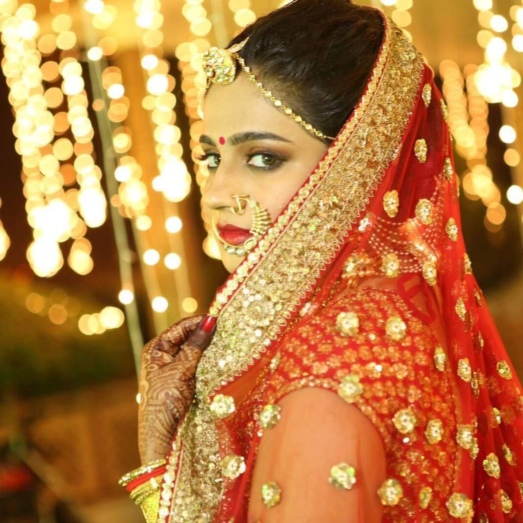 Traditional pose of a bride by Nishi Singh Bridal-makeup | Weddings Photos & Ideas