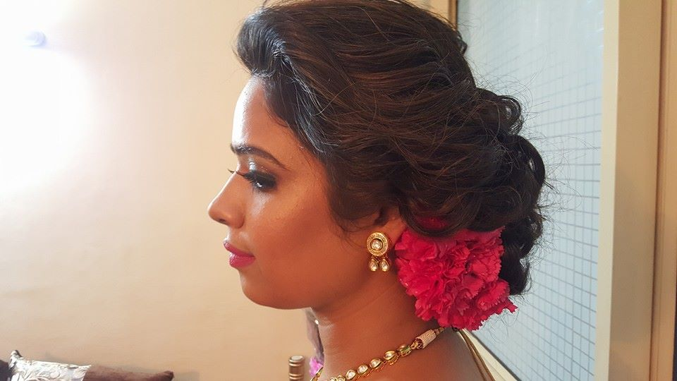 Not going for just any simple hairdo by Nishi Singh Bridal-makeup | Weddings Photos & Ideas