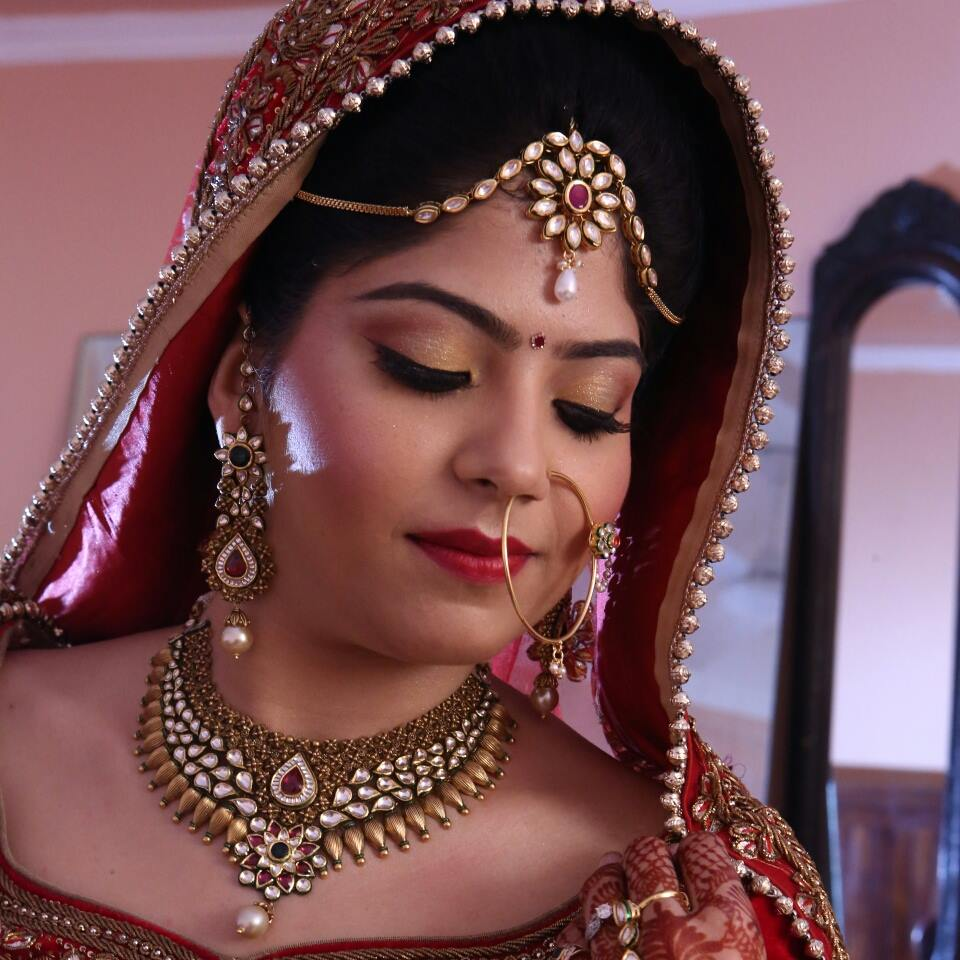 Beautiful bride with golden eye makeup by Nishi Singh Bridal-makeup | Weddings Photos & Ideas
