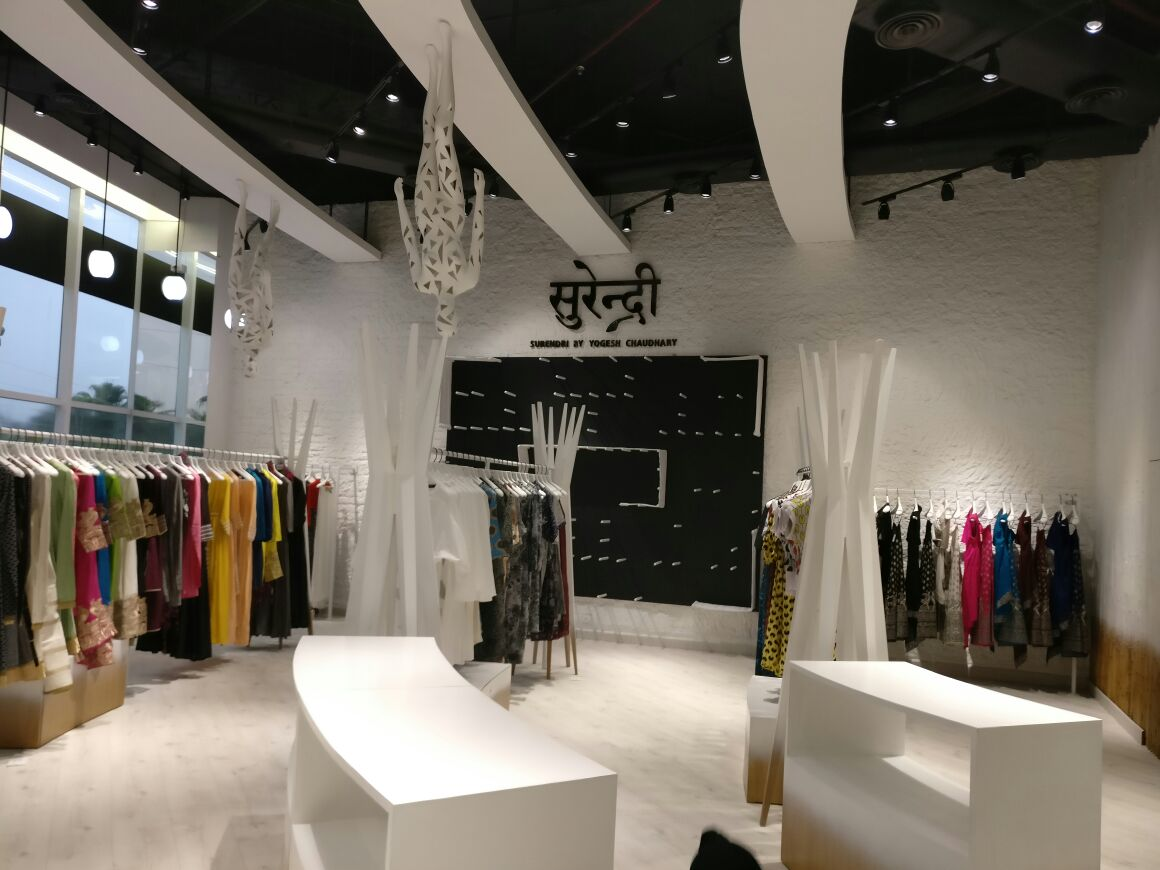 White Themed Showroom Reception by Abhinav Jain | Interior Design Photos & Ideas