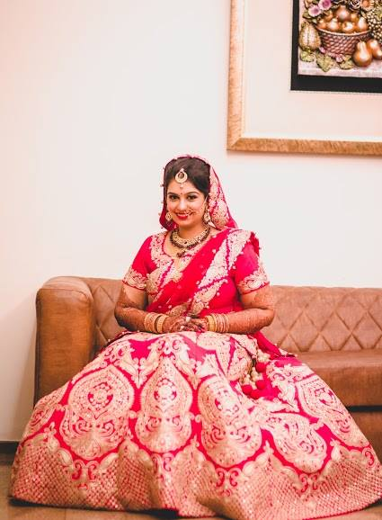 Charismatic Red lehenga with intricate gold by Ayushi Tayal Wedding-photography | Weddings Photos & Ideas