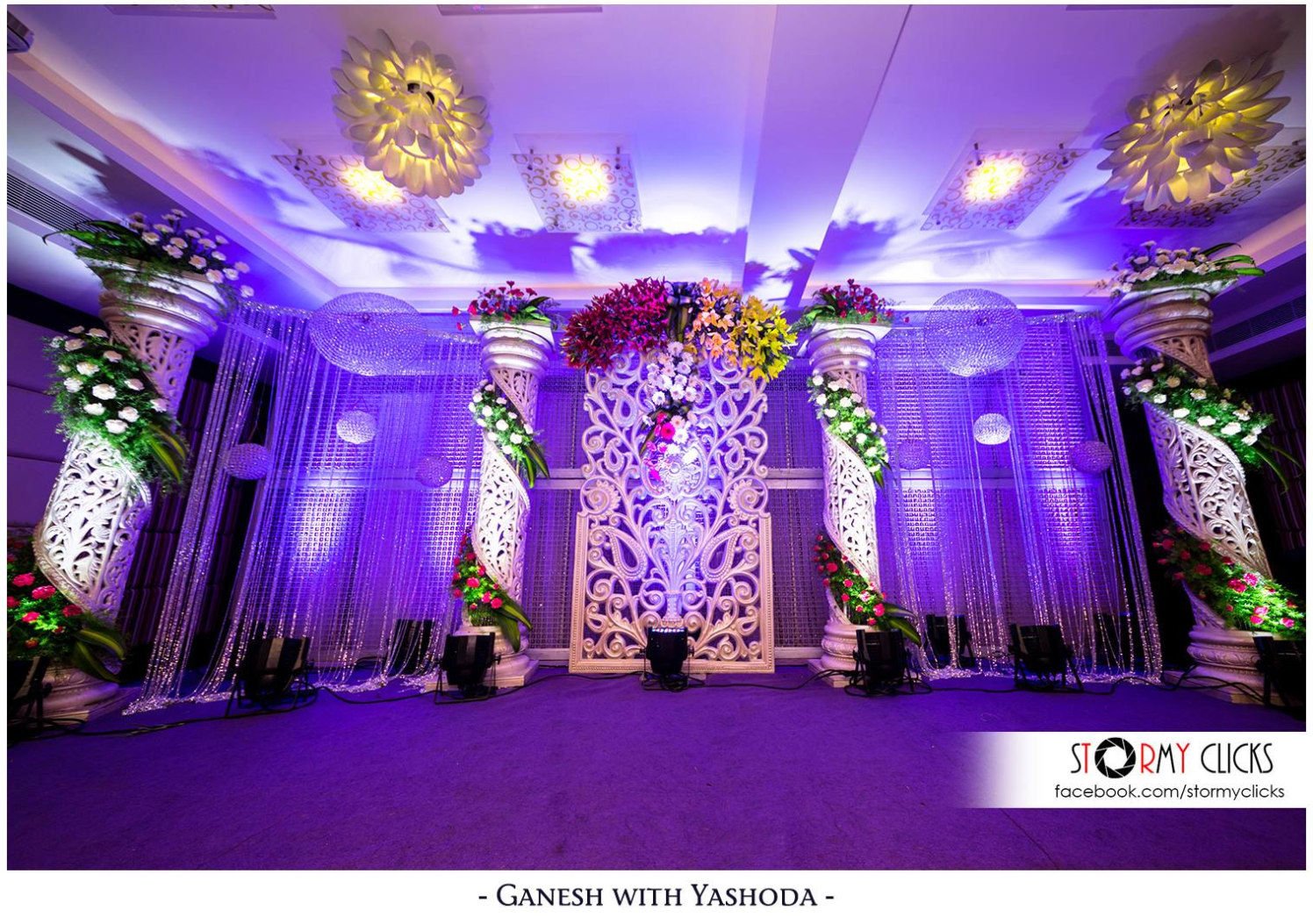 Glass Globe Chandelier Lamps With Floral Pillar Decorated Stage by Deepak Subramanian Wedding-decor | Weddings Photos & Ideas