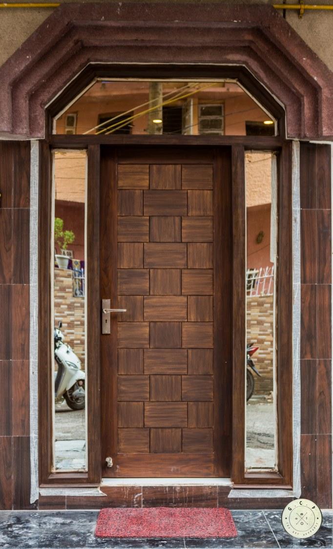 Contemporary entrance door by Designmantra Contemporary | Interior Design Photos & Ideas