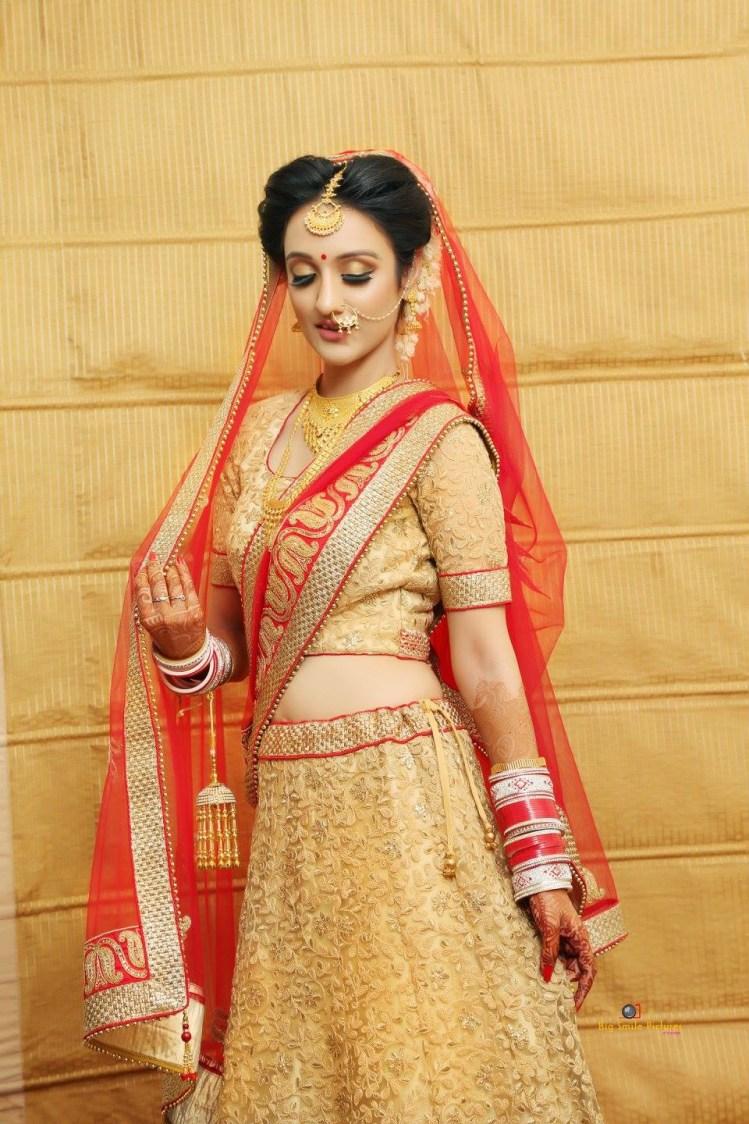 Bride Wearing A Delicately Embroidered Bridal Lehenga by Mukesh bijalwan  Bridal-makeup Wedding-dresses | Weddings Photos & Ideas