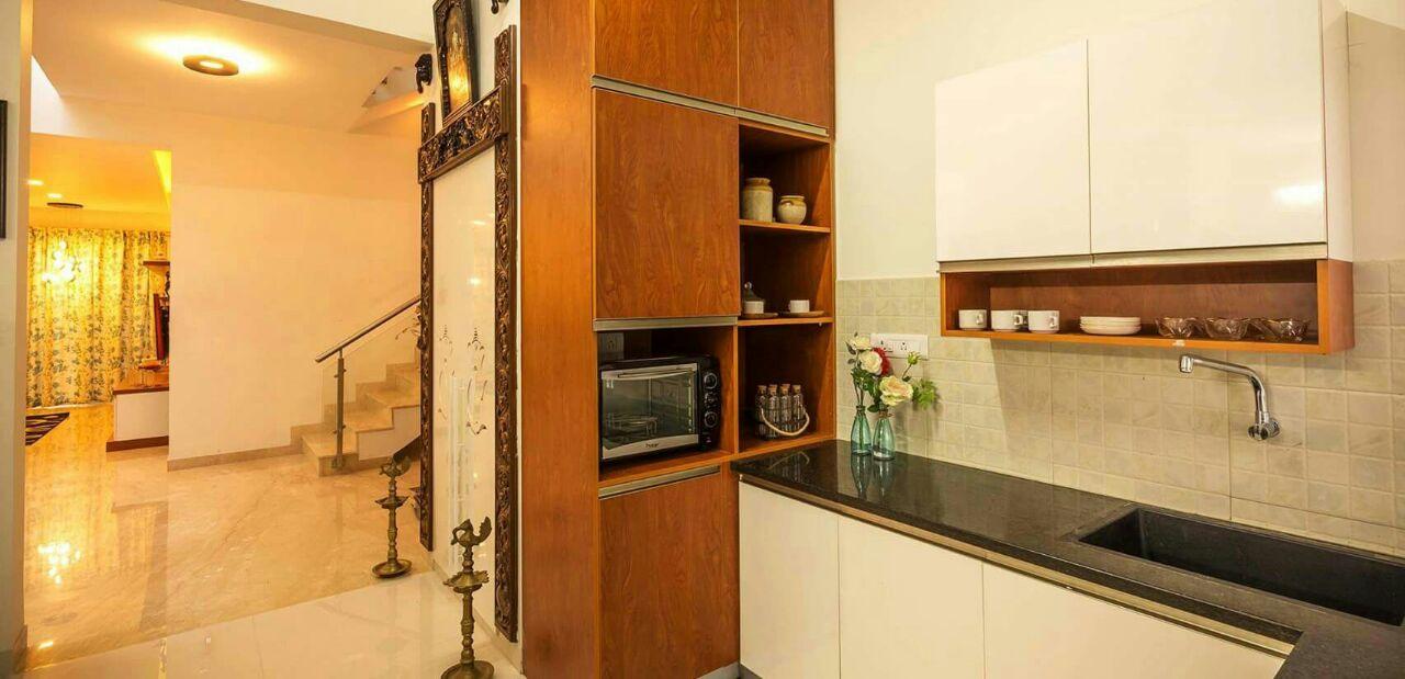 A modern L shaped modular kitchen by Interior Elements Modular-kitchen   Interior Design Photos & Ideas