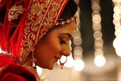 Candid shot of a bride by Sonam Jayna Bridal-makeup | Weddings Photos & Ideas