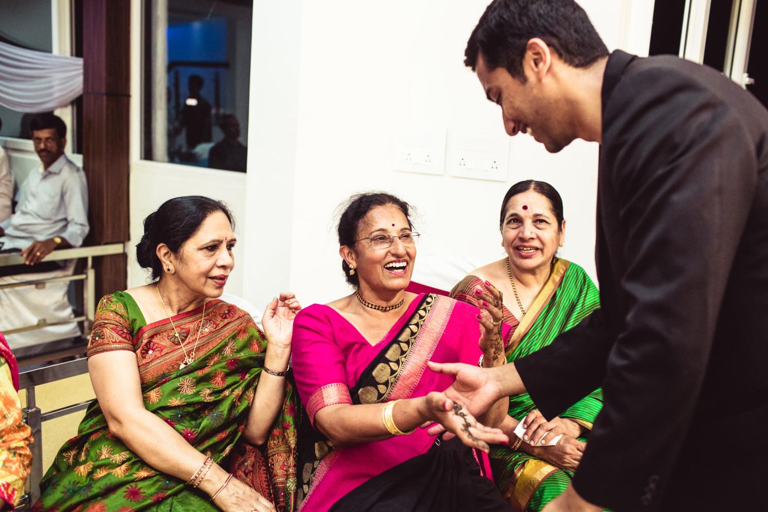 Checking the mehendi! by Manas Saran Photography Wedding-photography | Weddings Photos & Ideas