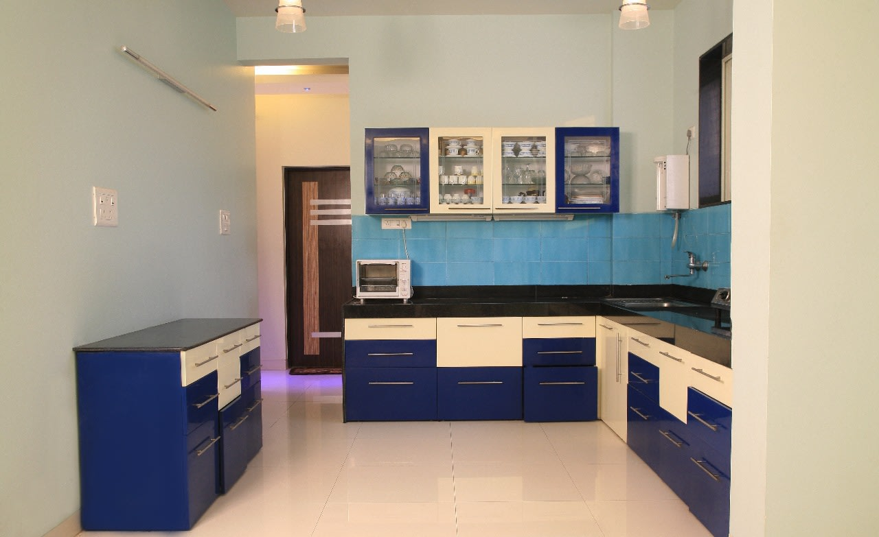 L shaped Counter Top with Dark Blue Base Drawers and glass paneled wall closet by Sudeep S Gandhi ID Modular-kitchen Contemporary | Interior Design Photos & Ideas