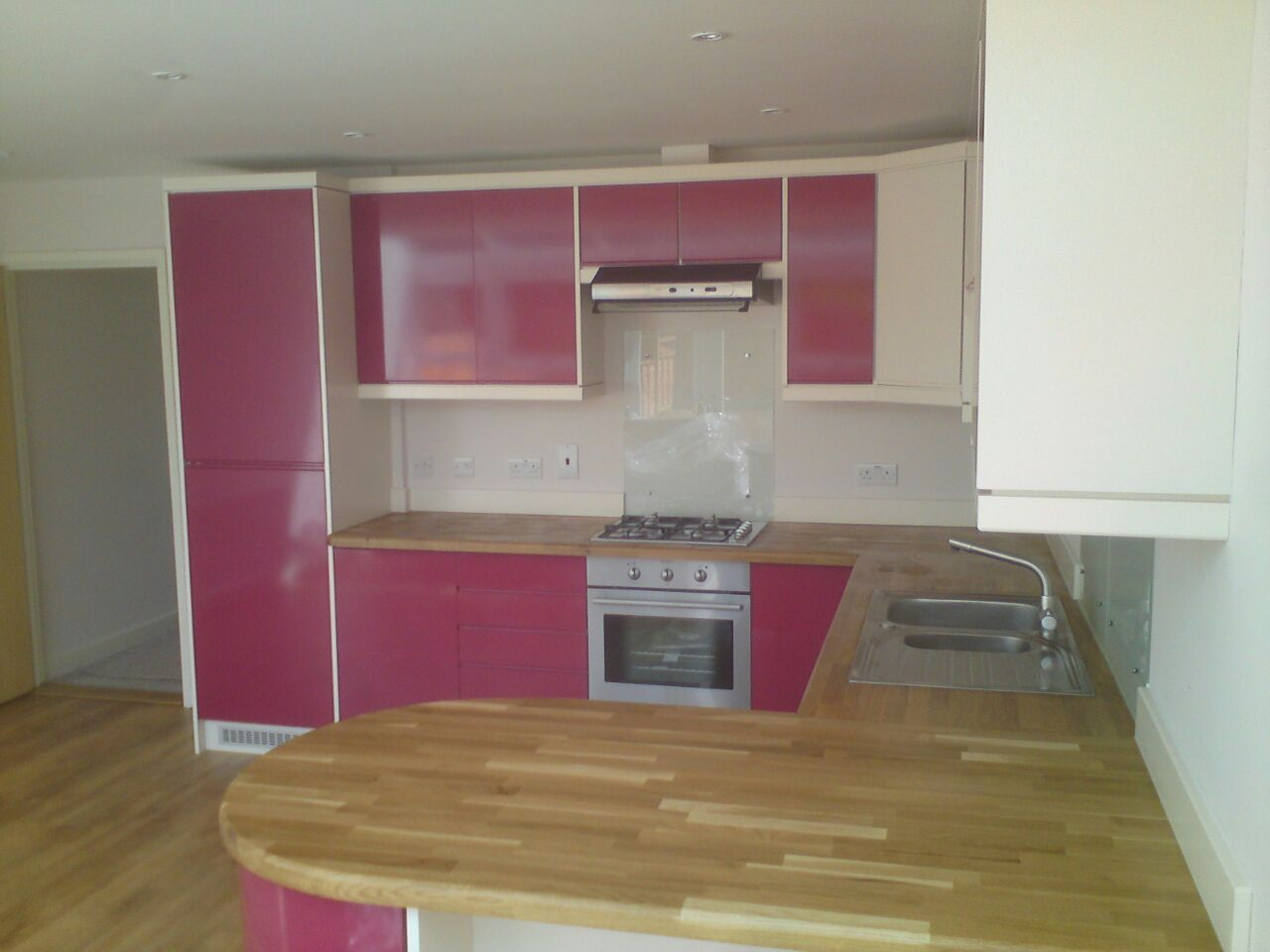 Pink Modular Kitchen with Wood Counter Top and Wood Flooring by Sudeep S Gandhi ID Modular-kitchen Contemporary | Interior Design Photos & Ideas