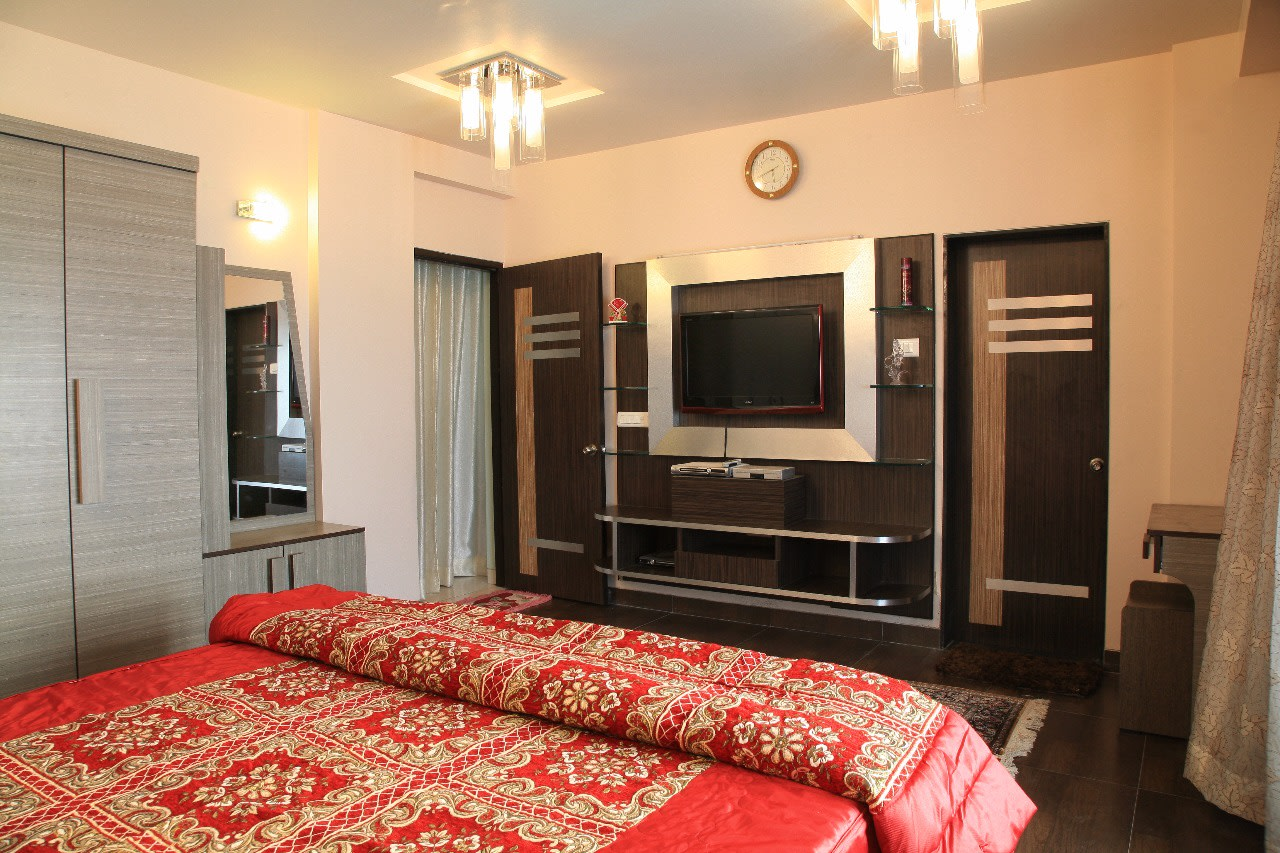 Master Bedroom with TV unit Hinged to Wooden Cabinet by Sudeep S Gandhi ID Bedroom Modern | Interior Design Photos & Ideas