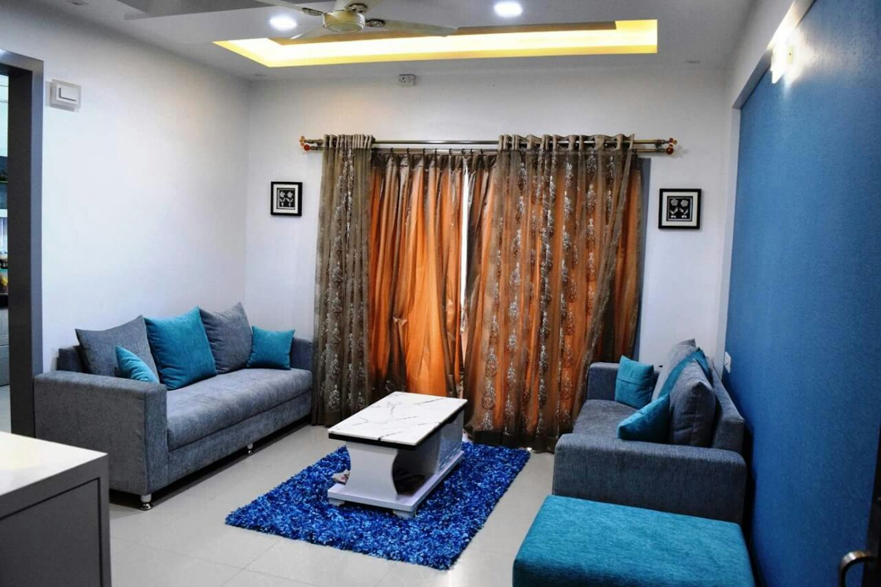 Blue Themed Living Room with Light Blue Sectional Sofa and LED False Ceiling by Sudeep S Gandhi ID Living-room Contemporary | Interior Design Photos & Ideas