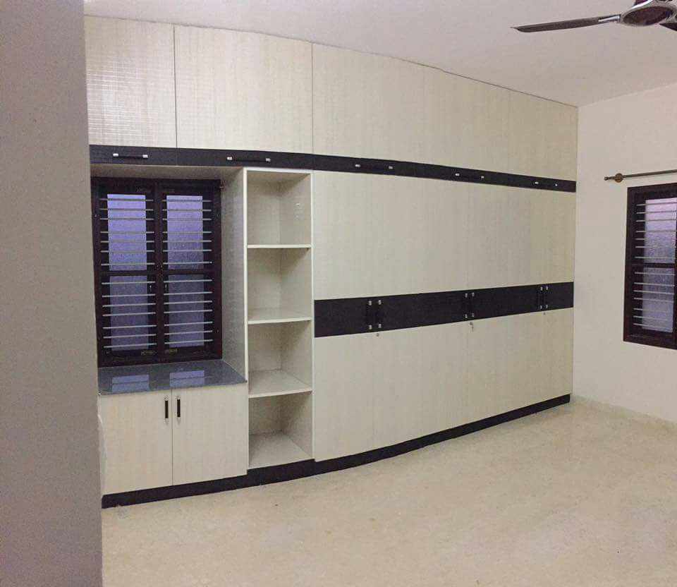 Hinged white wooden wardrobe with wall cabinet by Sudeep S Gandhi ID Bedroom Contemporary | Interior Design Photos & Ideas