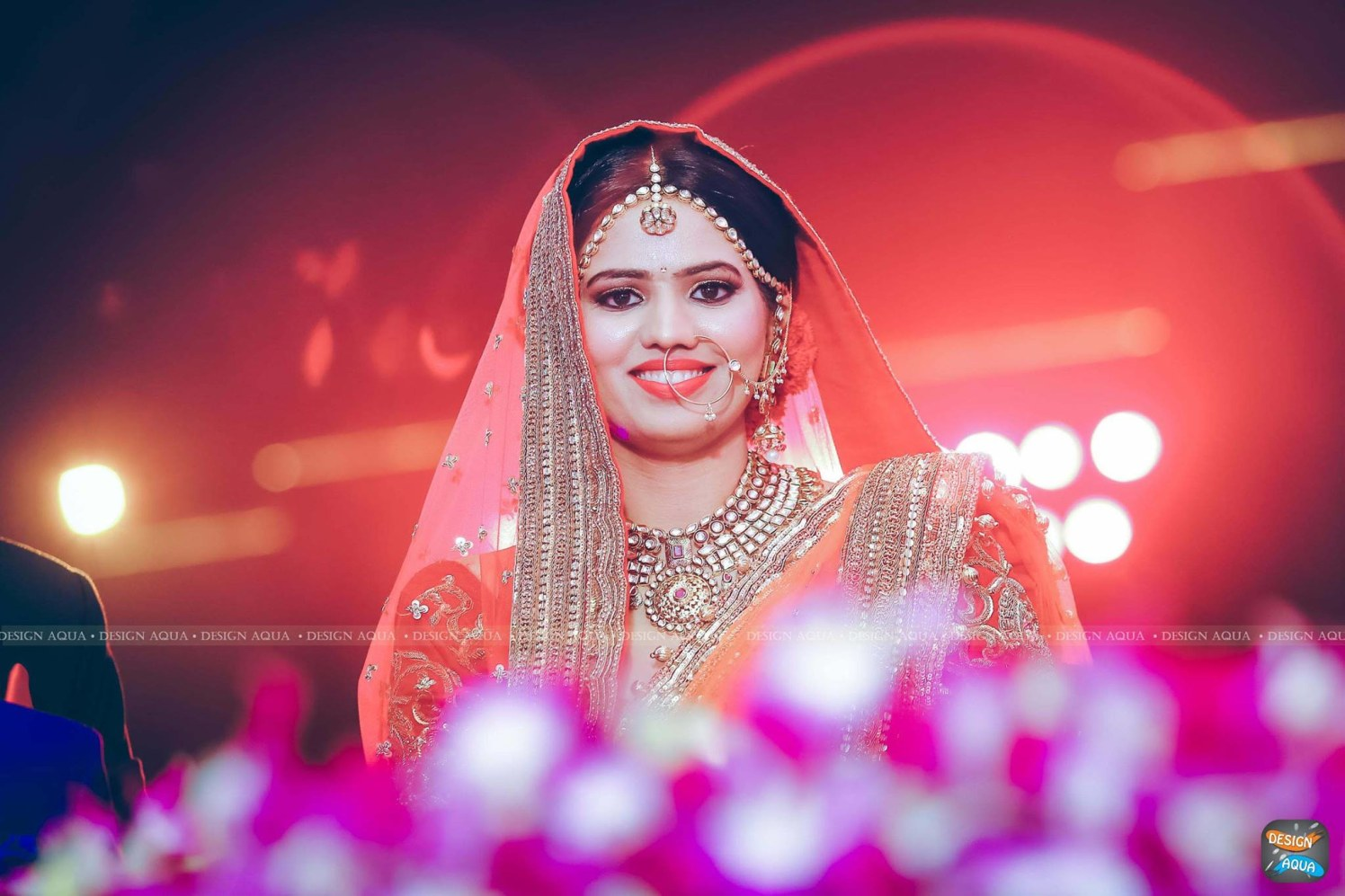 Light and Natural Makeup and Bright Red Lipstick Go Well With the Coral Shaded Attire of the Bride by Priyanka Kamboj Wedding-photography Bridal-jewellery-and-accessories Bridal-makeup | Weddings Photos & Ideas