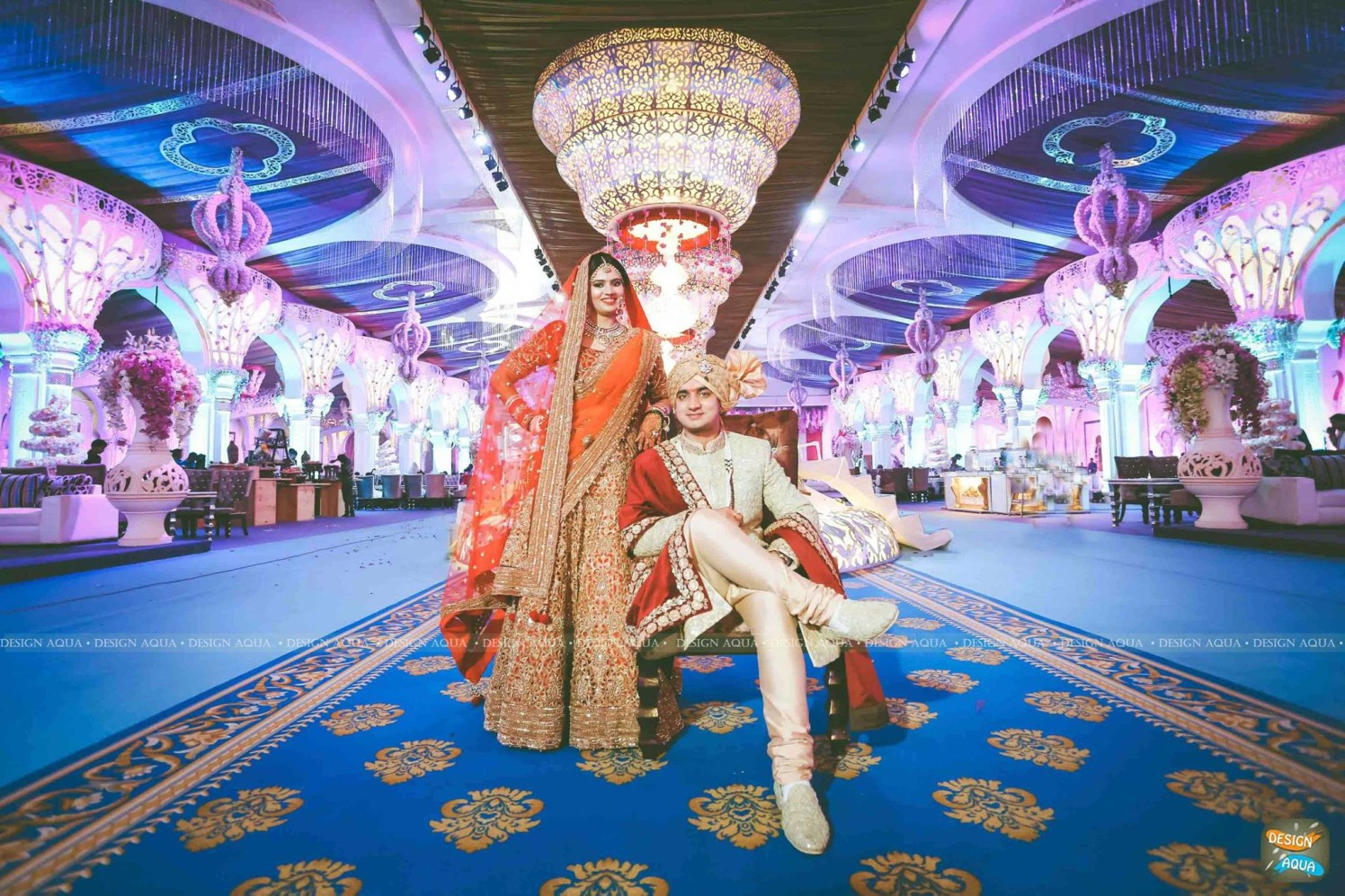 Orange Lehenga With Golden Threadwork Going Well With the Cream Sherwani of the Groom by Priyanka Kamboj Wedding-photography Groom-wear-and-accessories Wedding-dresses Wedding-decor | Weddings Photos & Ideas