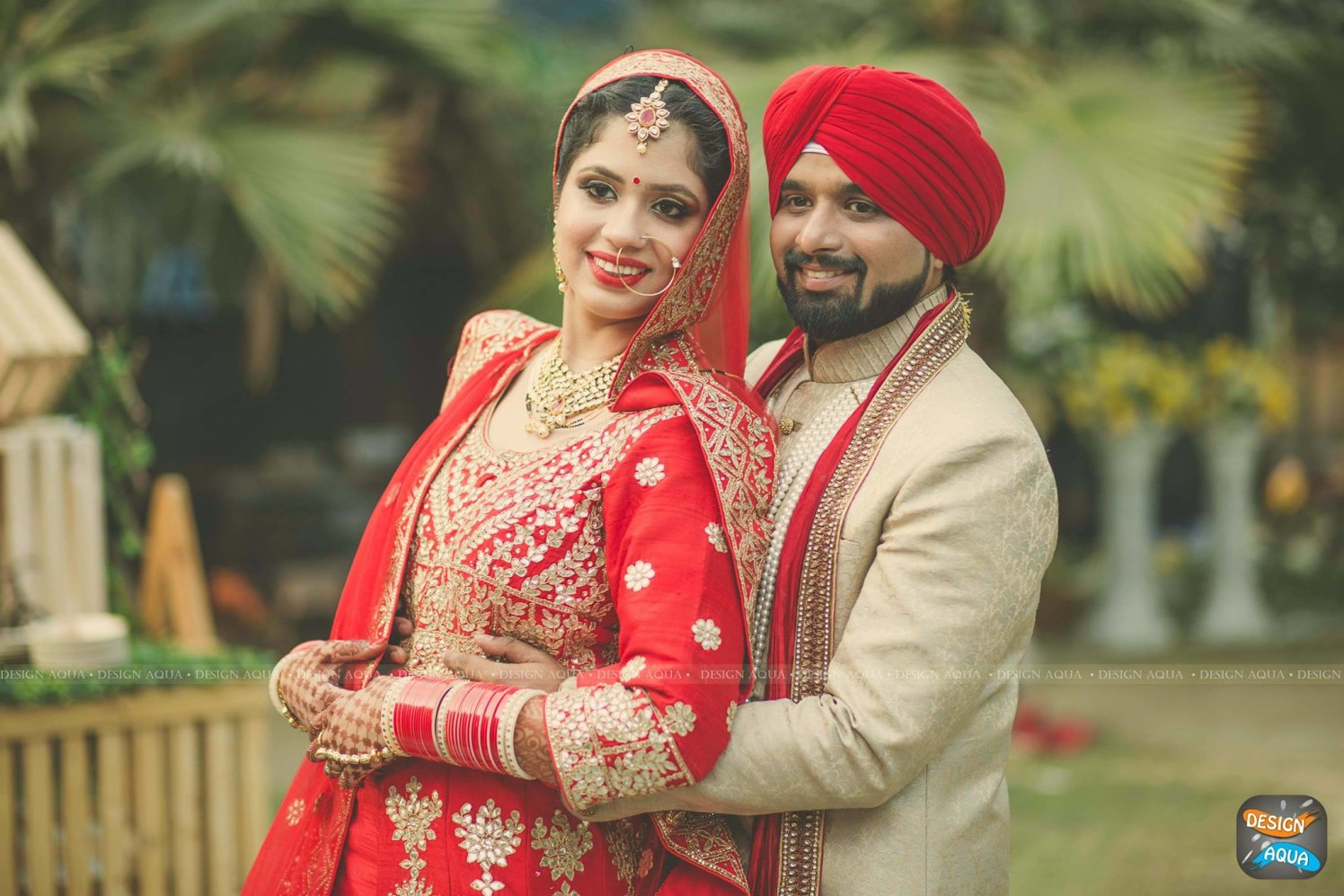 Crimson Red Lehenga of the Bride Complementing the Cream Sherwani of the Groom by Priyanka Kamboj Wedding-photography Groom-wear-and-accessories Bridal-makeup | Weddings Photos & Ideas