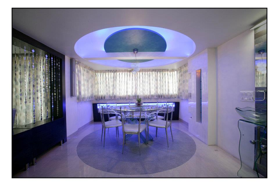 Spacious dinning area with blue neon lights by Hemangi Chaudhari-pawar  Dining-room Minimalistic | Interior Design Photos & Ideas