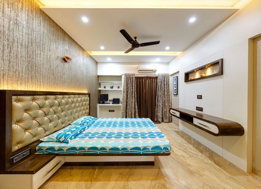 Wooden flooring bedroom with wall design by Hemangi Chaudhari-pawar  Bedroom Modern | Interior Design Photos & Ideas