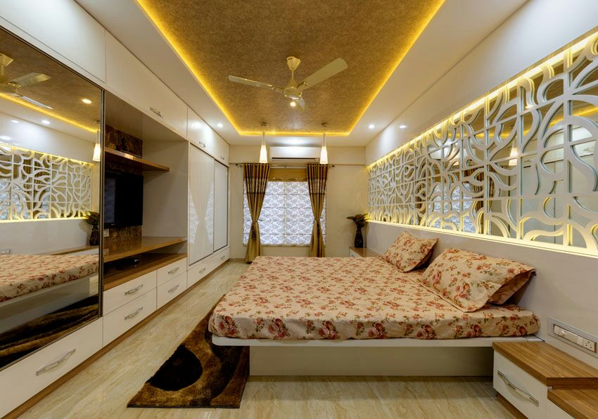 Wooden flooring  bedroom with false ceiling by Hemangi Chaudhari-pawar  Bedroom Contemporary | Interior Design Photos & Ideas