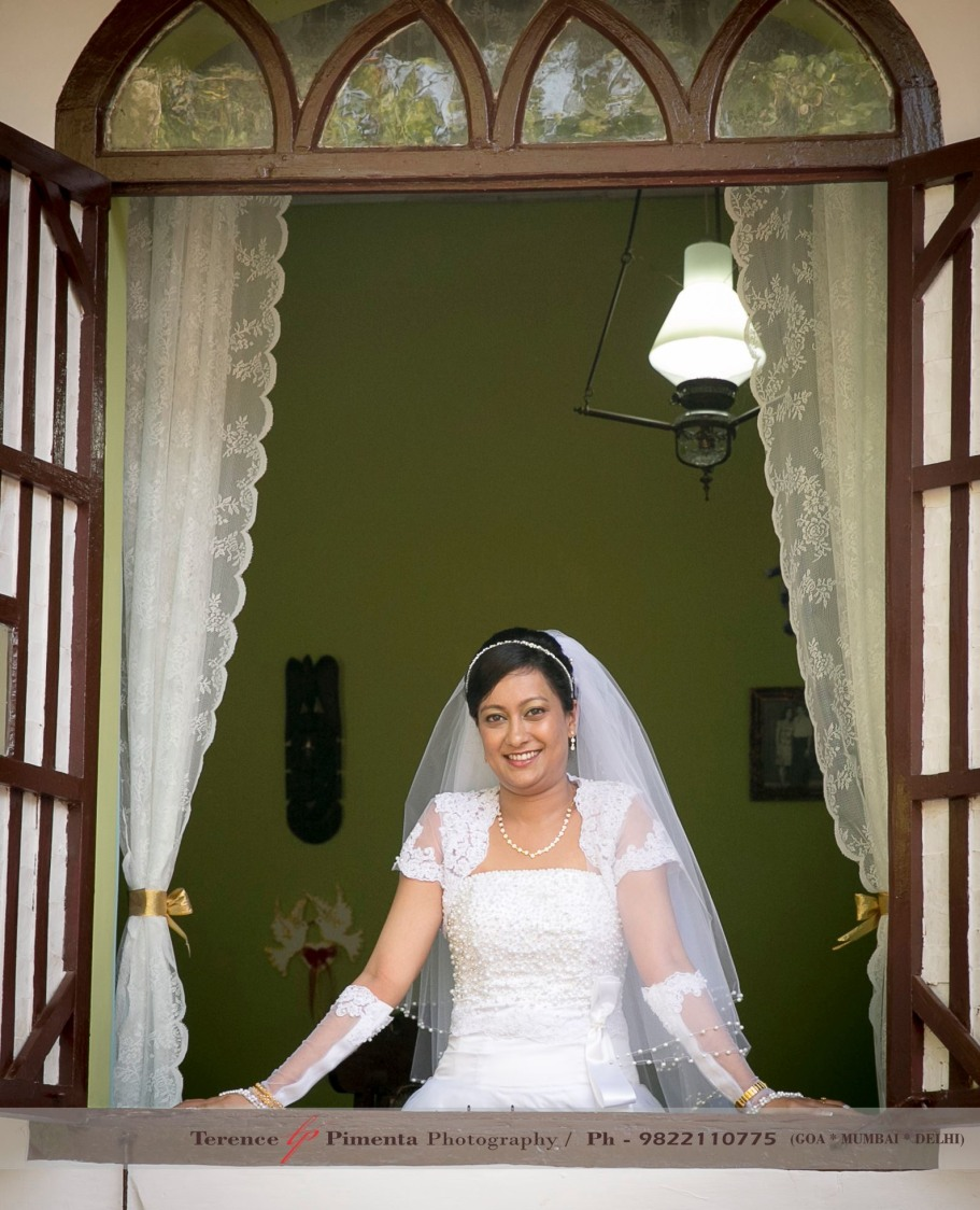Traditional Shot Of Christian Bride Through A Retro Style Window by Terence Savio Pimenta Wedding-photography | Weddings Photos & Ideas