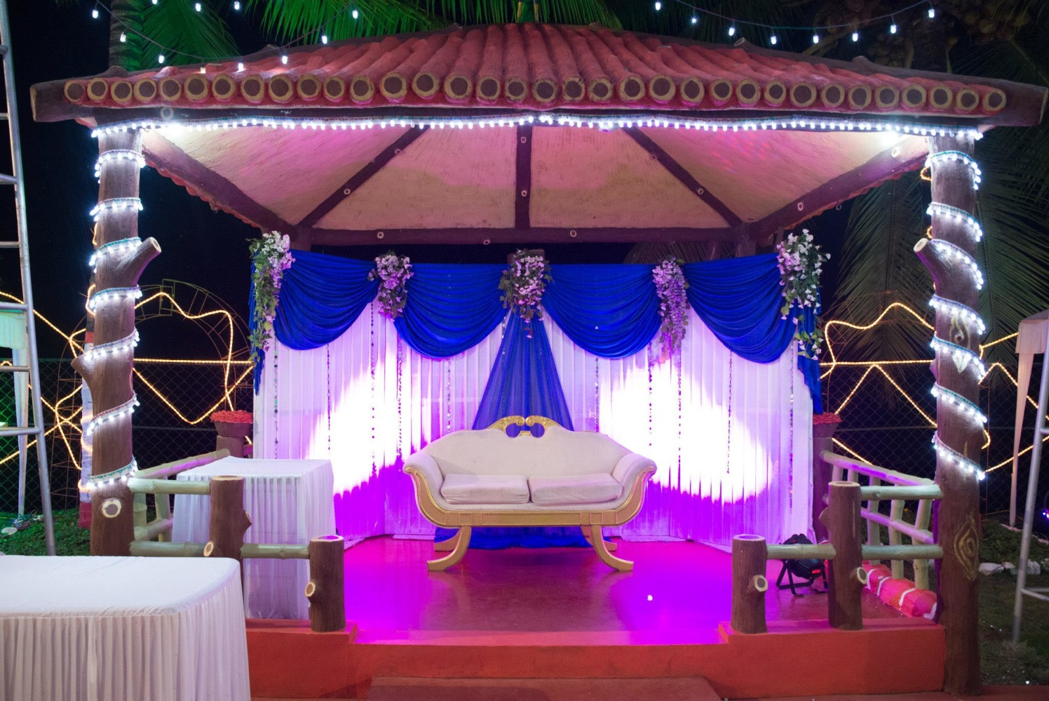 Hut Style Stage Setup With Blue And White Curtains And String Lights by Terence Savio Pimenta Wedding-decor | Weddings Photos & Ideas
