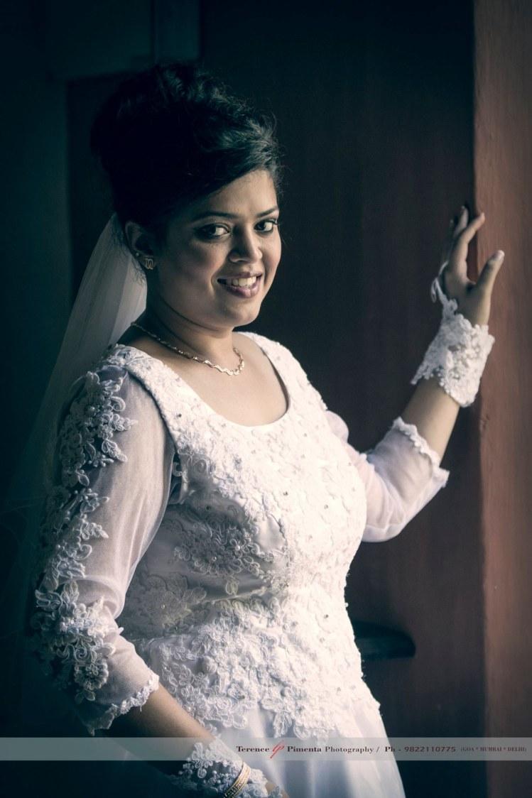 Side Shot Of Elegant Christian Bride In Gorgeous White Gown by Terence Savio Pimenta Wedding-photography | Weddings Photos & Ideas