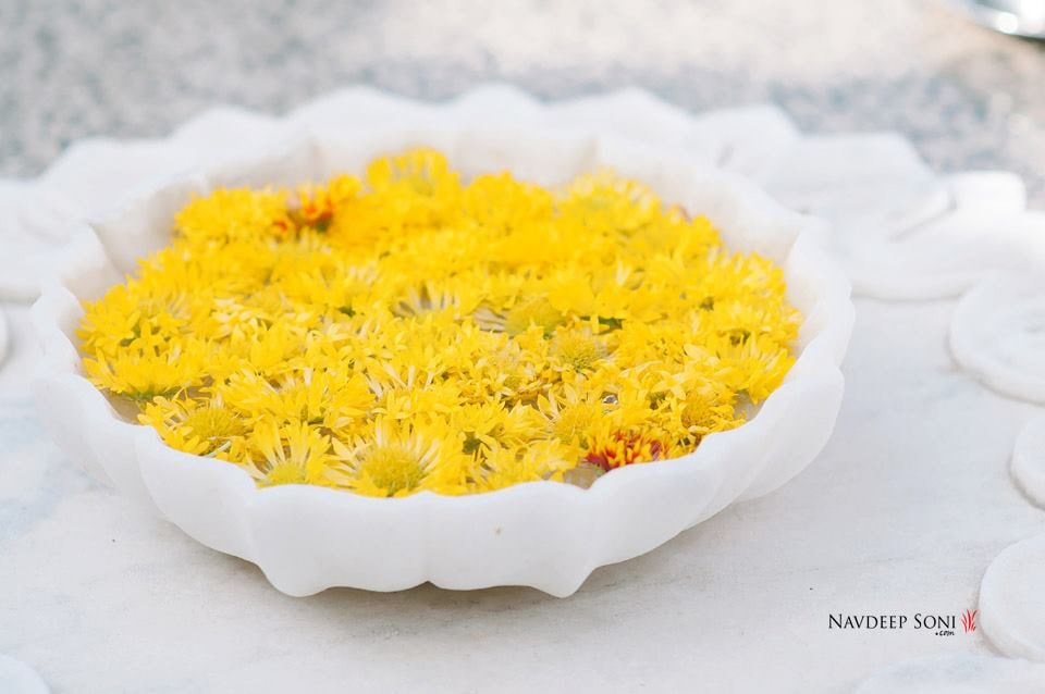 Yellow Marigold Flowers Floating In A White Centerpiece by Navdeep Soni Wedding-decor | Weddings Photos & Ideas