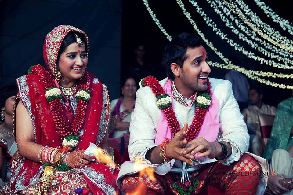 Candid Shot Of Merry Bride And Groom During Their Wedding Ceremony by Navdeep Soni Wedding-photography | Weddings Photos & Ideas