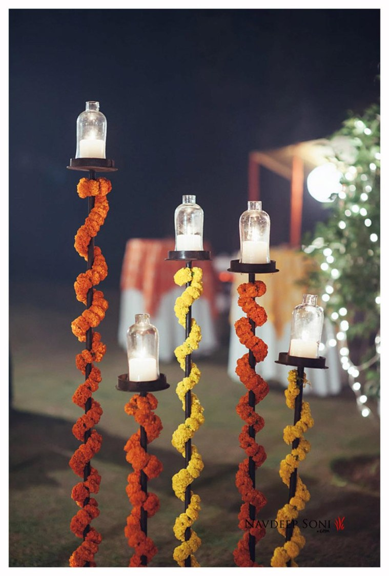 Stylized Candle-Stands Spiraled With Garlands by Navdeep Soni Photography Wedding-photography | Weddings Photos & Ideas