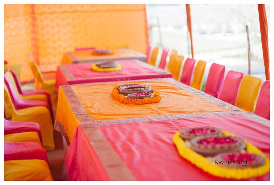 Saffron And Pink Themed Seating Wedding  Decor With Marigold And Rose Petals Center Pieces In Center by Navdeep Soni Wedding-decor | Weddings Photos & Ideas