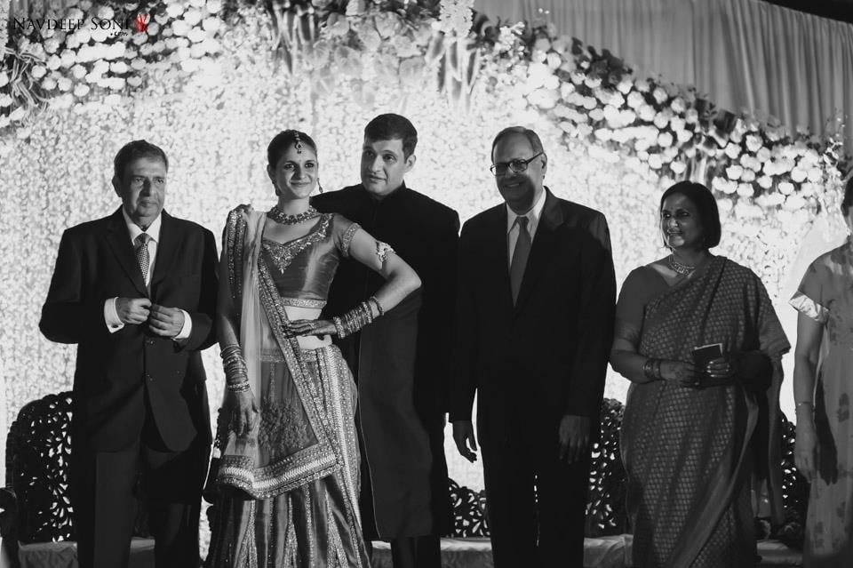 Black And White Shot Of Bride And Groom Striking A Pose With Wedding Guests by Navdeep Soni Wedding-photography | Weddings Photos & Ideas