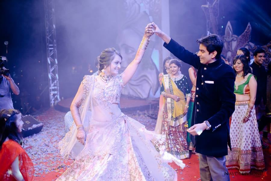 Captivating Sight Of Bride Twirling On Stage by Navdeep Soni Wedding-photography | Weddings Photos & Ideas