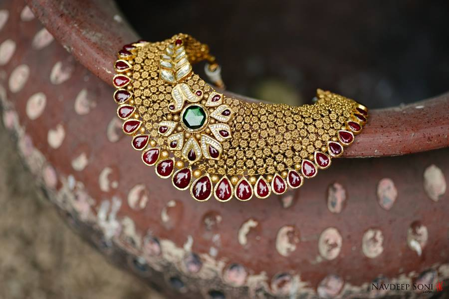 Eye Catching Gold Detailed Necklace Embedded With Red And Green Gemstones by Navdeep Soni Wedding-photography Bridal-jewellery-and-accessories | Weddings Photos & Ideas