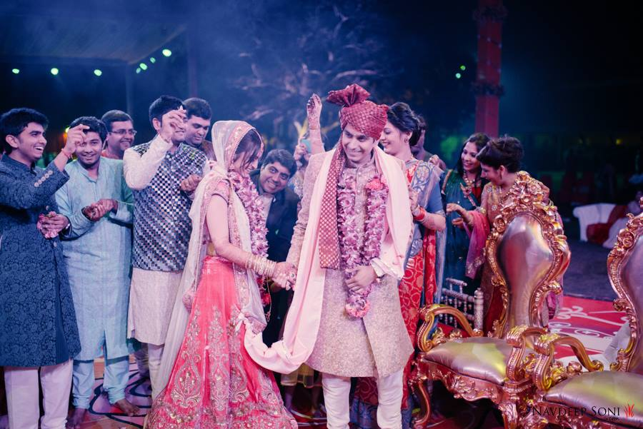 Candid Shot Of Bridegroom Amidst The Nuptial Round Ritual by Navdeep Soni Wedding-photography | Weddings Photos & Ideas