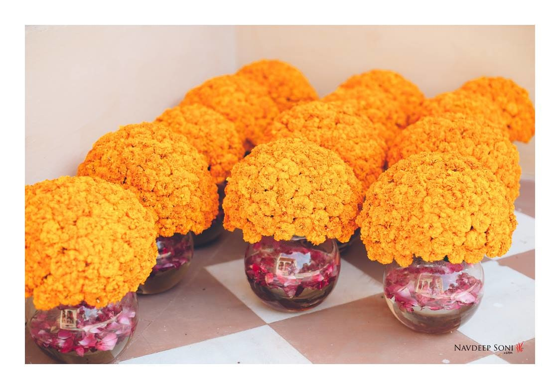Yellow Marigold Flowers In Glass Containers For Traditional Wedding Decor by Navdeep Soni Wedding-decor | Weddings Photos & Ideas